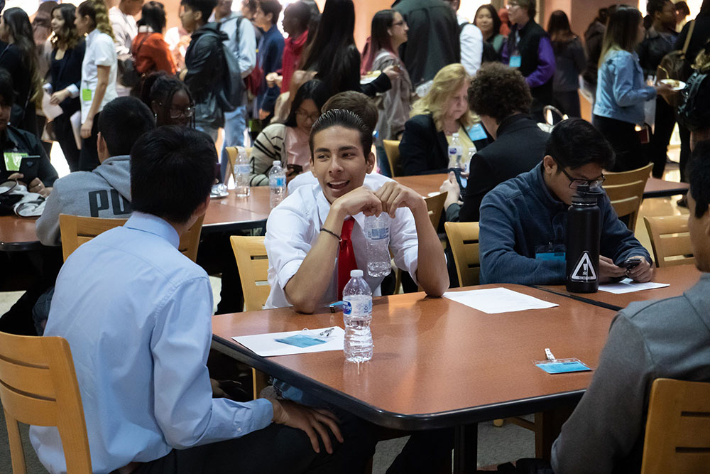 Students socialize at tables