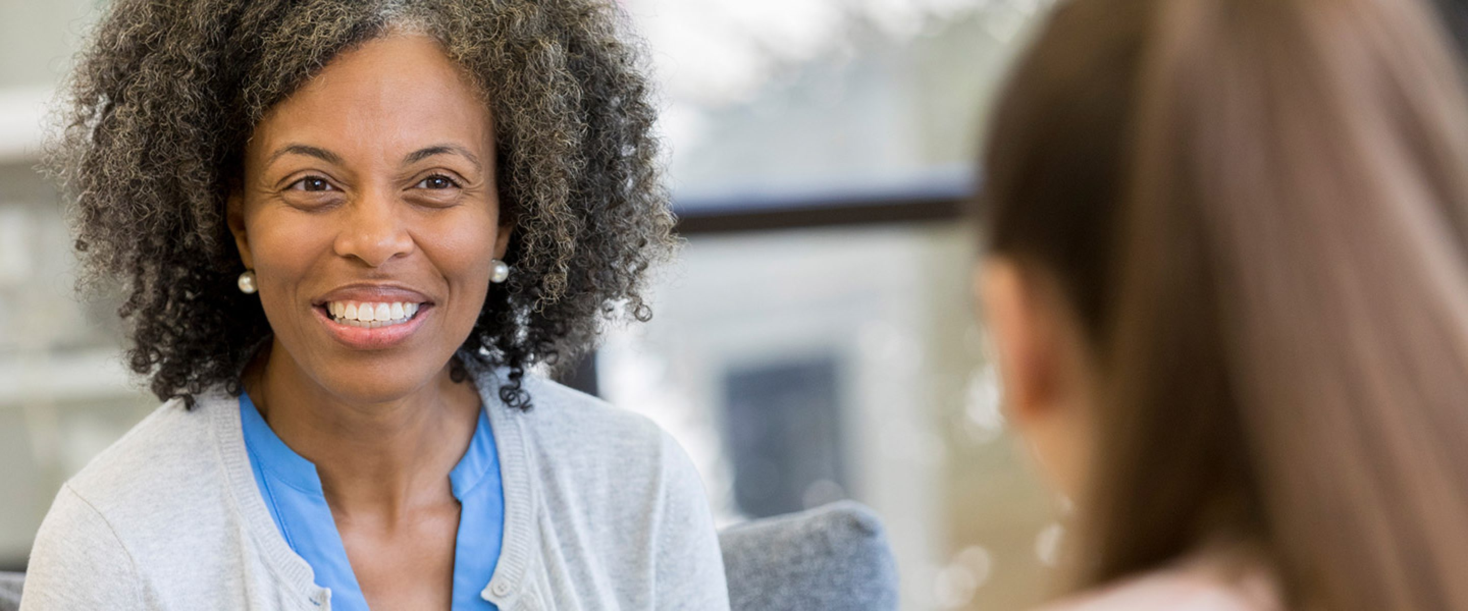 African American educator meets with young female student